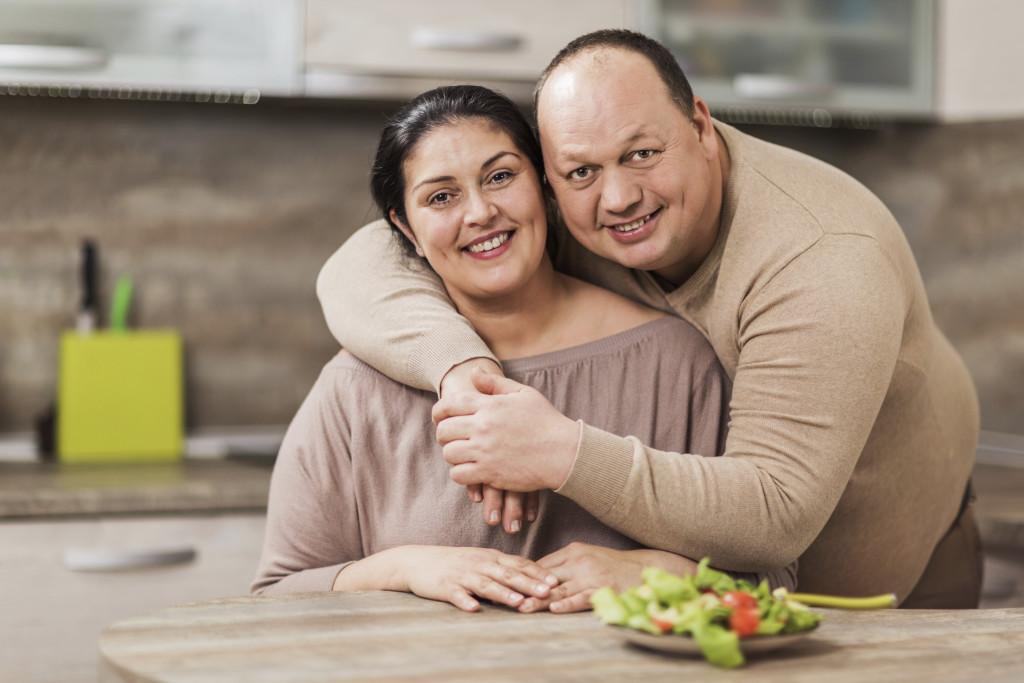 Happy overweight couple.